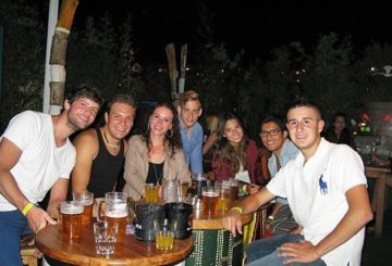 Group of cheerful EasyFrench's students enjoying drink